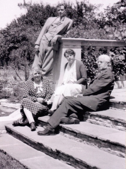 Family seated on the steps of the garden